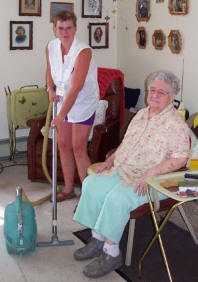 Home maker helper providing housekeeping service for older adult.