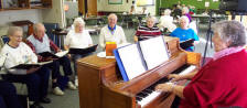 Group of older adults enjoy singing together at the Commission on Aging
