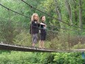 Children looking over the hanging bridge
